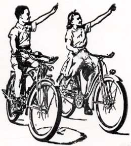 Young Bicycle Riders Waving. Letterpress Metal Cut Artist.