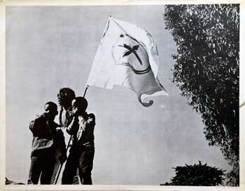The Blessed Trinity [Poster] [African-American woman and 2 boys with radical flag]. Michael Culbertson, photographer.
