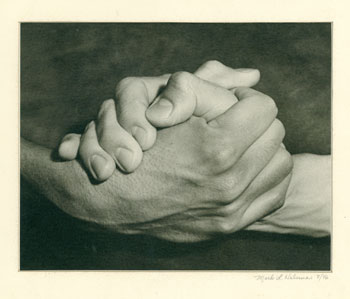 [Black and white photograph of clasped hands]. Mark L. Haberman.