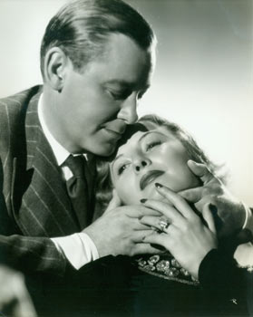 An Engagement Ring? Promotional Photograph of Barbara Stanwyck & Herbert Marshall for RKO Radio's 1937 film, Breakfast For Two. Ernest A. Bachrach, RKO Radio Pictures, phot.