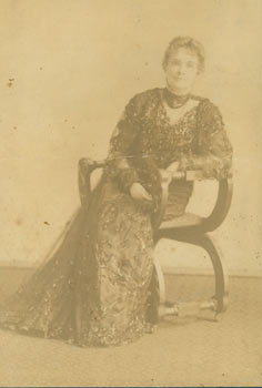 Monochrome Photograph of a woman seated in chair. 19th Century American Photographer.