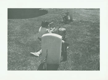 Black and White Photographic Print of two children playing behind gravestone of Lt. Col. Roy Harold Swanson US Air Force (1912-1961). 20th Century American Photographer.