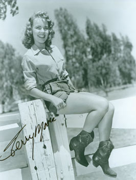 Autographed Black and White Photograph of American Actress Terry Moore. Mid 20th Century Hollywood Photographer.