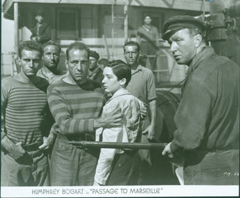 Promotional 8x10 Black & White Glossy Photograph of Humphrey Bogart for Passage To Marseille. Warner Brothers.