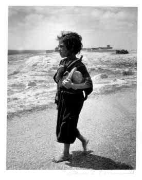 [A Girl Walking on the Beach Holding Her Shoes]. Gerda S. Mathan.