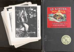 Personal notebook, two postcards, and a stack of reproductions of the photographer's work....