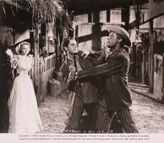 "Evelyn Keyes, Glenn Ford, and Randolph Scott in ""The Desperadoes"", 1943. Columbia Pictures"