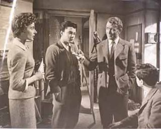 "John Mills, Sean Barrett, Yvonne Mitchell, and Jeremy Spencer in ""Escapade"", 1955. Eros Films"