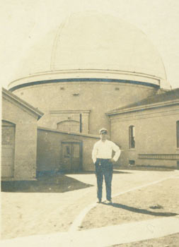 Photograph of man standing before an observatory. 19th Century American Photographer