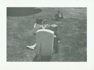 Black and White Photographic Print of two children playing behind gravestone of Lt. Col. Roy...