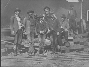 Photo of men and boys building a railroad. Anonymous