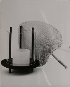 Still life of candle and fan. Modern photographer